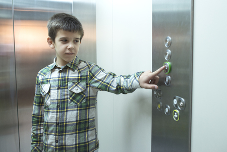 pushed: Child pushed a button in an elevator.