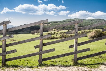 ranch: Wooden fence on a mountain ranch. Sunlight