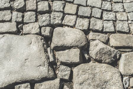 paved: Old paved road and big stones Stock Photo