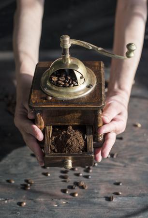 grind: Grind coffee with vintage coffee grinder.