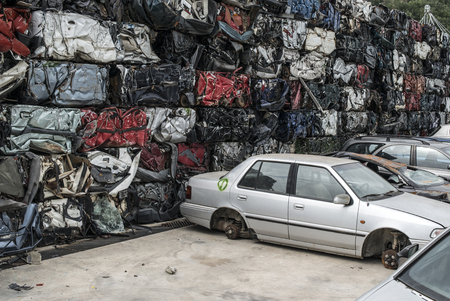Baled scrap cars in depot for old cars.