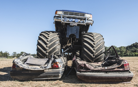 Monster truck over cars. Blue sky Stock Photo