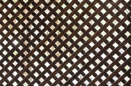 wooden partition: Latticed wooden partition. Back light Stock Photo