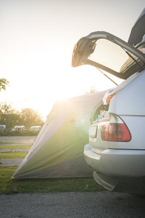 campsite: Tent and car on campsite. Sinrise back light