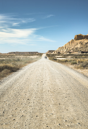 navajo land: Wild west road and blue sky Stock Photo