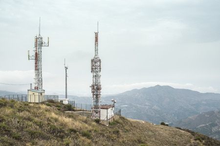 gsm: Telecommunication (GSM) towers with TV antennas on the mountain Stock Photo