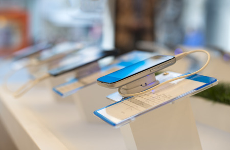Smartphones in a shop. Buy smartphone. Telecommunication shop. Showcase with phones