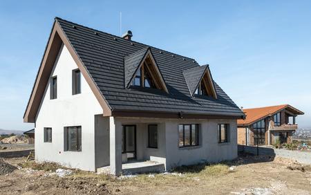 New build houses. Sunny day. Construction site Zdjęcie Seryjne