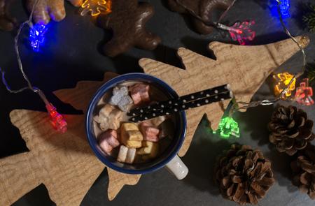 Marshmallow and milk on christmas table. Tree shape