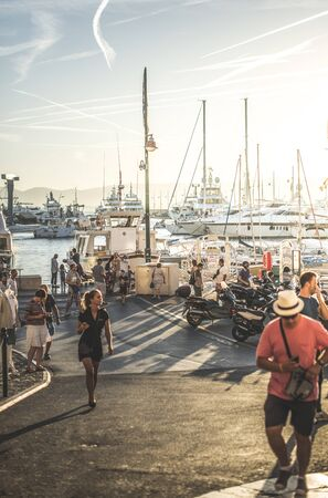 Marina with Boats and tourists on sunset. St Tropez resort in France. French riviera. Many people walking in Saint tropez. Travel in France, Europe concept. Editorial
