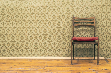 Victorian style vintage pattern wallpaper. Ornamental background and chair. Pastel tones.