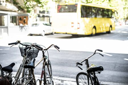 Vintage bikes in city of Ravenna, Italy. Bus on the background. Imagens