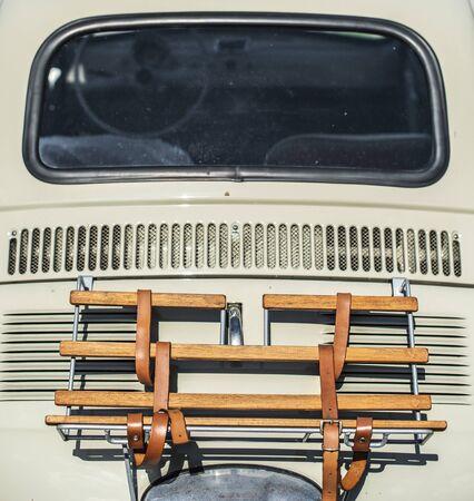 Vintage beige color car trunk. Small old car. Italian car. Sunny day Reklamní fotografie