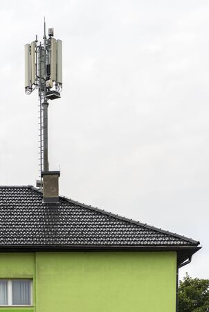 5G antennas on top of house. Antennas and transmitters on roof. High speed mobile internet concept. Stock fotó