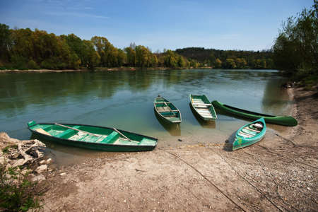 Five boats on the river bank Stock Photo