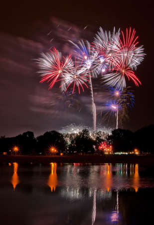 Huge fireworks with reflection in the lake Stock Photo