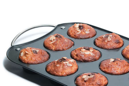 Muffin tin with fresh muffins Stock Photo