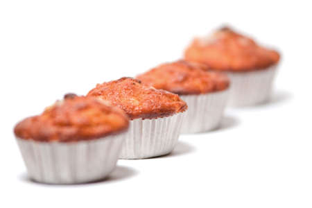 Four freshly made muffins in a row with shallow depth of field Stock Photo - 6902419