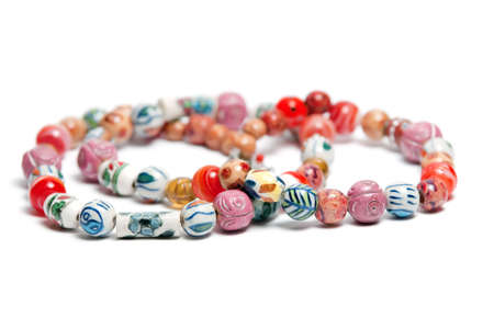 A necklace with beads in varius colors and patterns Stock Photo