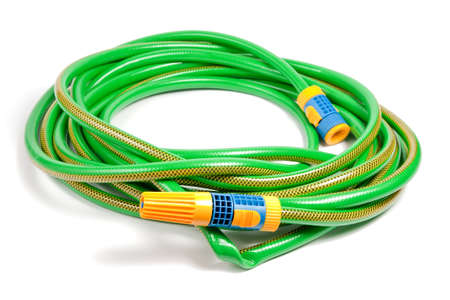 Green and yellow garden water hose with yellow sprinkler isolated on white background