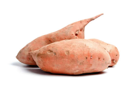 spud: Three sweet potatoes isolated on white background Stock Photo