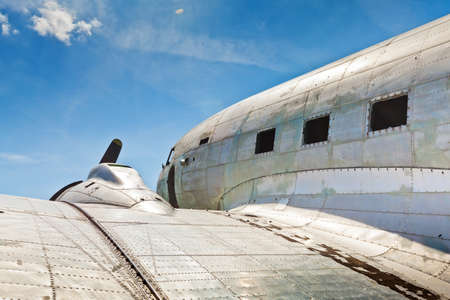 Remains of an abandoned Dakota DC3 aircraft from World War II on an airfield near Otočac, Croatia
