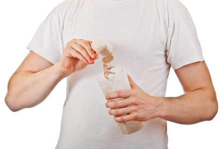 whey: Man preparing his post workout protein shake with a scoop of chocolate whey isolate powder in the shaker isolated on white Stock Photo