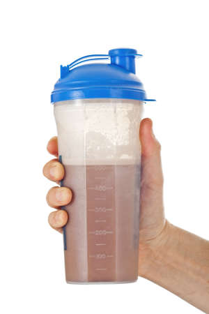 Mans fist holding the post workout chocolate whey protein shake, ready to drink it, isolated on white photo