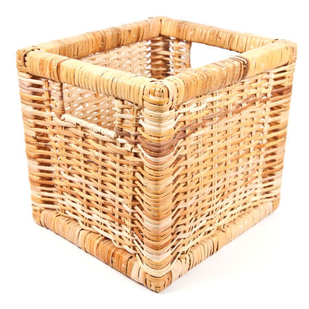 Empty wicker basket in the shape of the cube on white background  photo