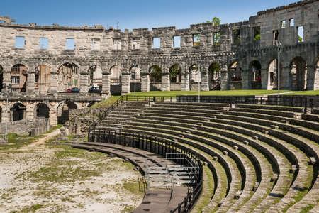 The inside of the ruins of the ancient Roman amphitheatre colloseum in Pula, Croatia  photo