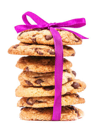 chocolate chip cookie: Stack of chocolate cookies tied with pink ribbon isolated on white background  Stock Photo