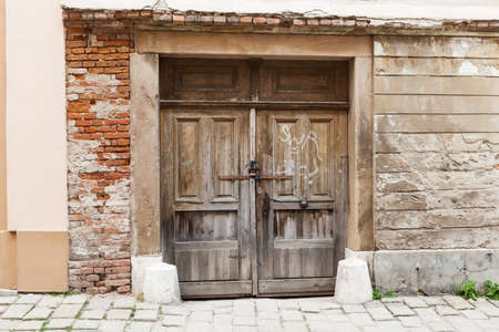 Brown old rustic withered wooden doors in Bratislava, Slovakia Stock Photo - 19704086