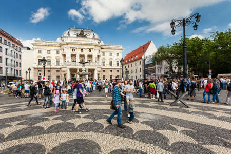 People in front of Slovak National Theater on Hviezdoslav Square in the Old Town on May 9, 2013 in Bratislava, Slovakia. It is the second oldest Slovak professional theatre.