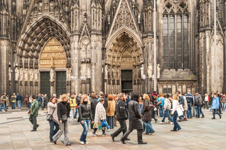 Tourists and residents in front of the Cologne Cathedral on March 18, 2007 in Cologne, Germany. It is Germanys most visited landmark visited by 20.000 people a day.