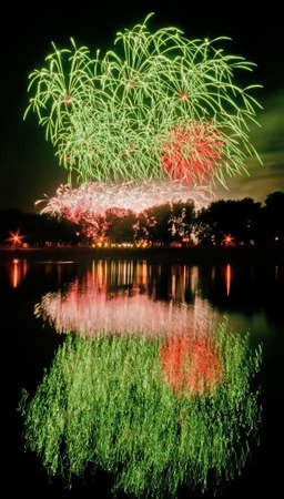 Huge fireworks with reflection on the water photo