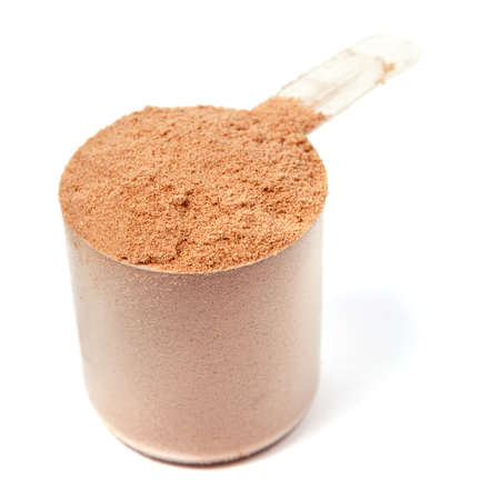 A scoop of chocolate whey protein powder isolated on white background photo
