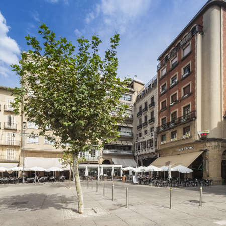 Plaza del Castillo in city center in Pamplona, Spain. City is famous for its San Fermin festival in which bulls run and chase people on city streets.
