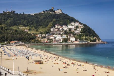 Sandy beach of La Concha in San Sebastian, Spain. With length of 1350 meters and 40 meters wide, it is one of the most famous urban beaches across Spain.