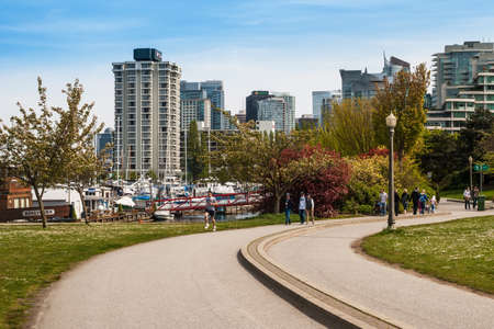 devonian: People jogging and walking at the Devonian Harbour Club in Vancouver, Canada. It was opened in 1984 after Devonian Foundation in Alberta donated $600,000. Editorial