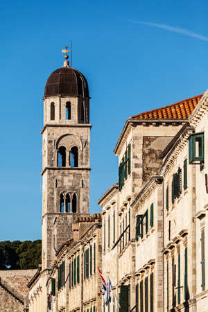 franciscan: Tower of the Franciscan Monastery of the Friars Minor and other buildings along the Stradun, main street in Dubrovnik, Croatia