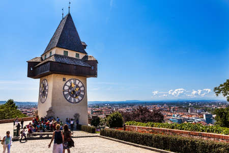 28m tall clock tower (Uhrturm) in Graz, Austria. It was built in 16th century; its handles have opposite roles - larger marks hours and smaller marks minutes. Redakční