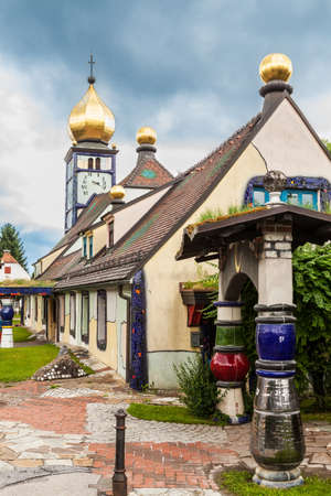 Church of St. Barbara in Bärnbach, Styria, Austria. Church was built in 1948 and was renovated by Friedensreich Hundertwasser in 1987.