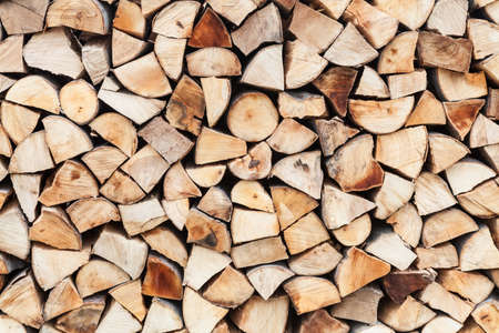 Neat arrangement of chopped wood prepared and stored for cold winter days Stock Photo