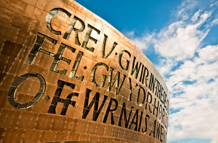 emphasised: Wales Millenium Centre hosting welsh opera and arts center. The face of the building is emphasised by a spectacular set of windows, made in the form of letters, that read together as a poem. Editorial