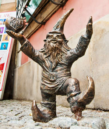 Statue of a gnome in Wroclaw, Poland. Statues of dwarfs appeared on the streets of  the city in August 2005. Their history is connected with the Orange Alternative movement and the year 1982. It is then that some dwarfs with funny hats and smiling faces w