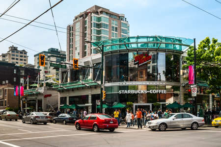 Starbucks Coffee at Robson & Thurlow in Vancouver, Canada. Starbucks is world Editorial