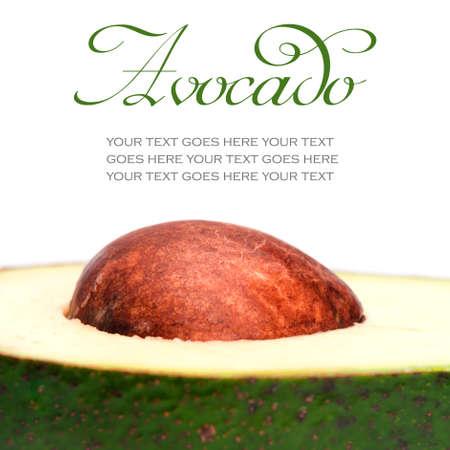 Close-up van avocado pit geïsoleerd op een witte achtergrond, met tekst staan in voor de kopie ruimte Stockfoto