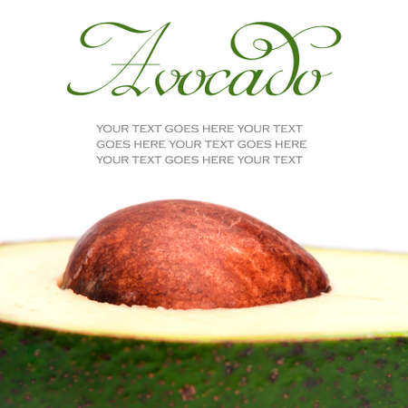 Closeup of avocado pit isolated on white background, with text standing in for copy space