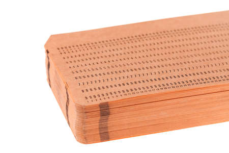 punched: Stack of vintage unused computer punch cards used for programming and data entry in the sixties and seventies, isolated on white