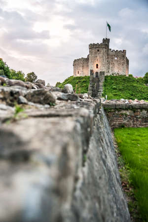 middleages: Cardiff castle, a medieval Victorian Gothic revival castle, situated in the city centre of Cardiff, Wales, United Kingdom; evening shot